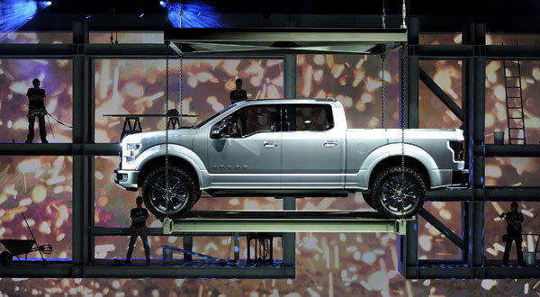 The Ford F-150 Atlas concept truck is lowered during its unveiling at the 2013 North American International Auto Show in Detroit.