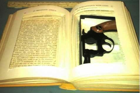 A book with high-caliber content: This gun, missing a part, was found in a hollowed-out book at the Honolulu International Airport.