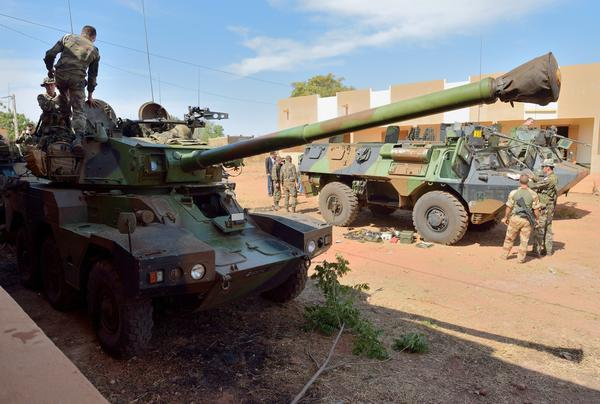 French troops prepare armored vehicles in Abidjan, Ivory Coast, before their deployment in the north of Mali.
