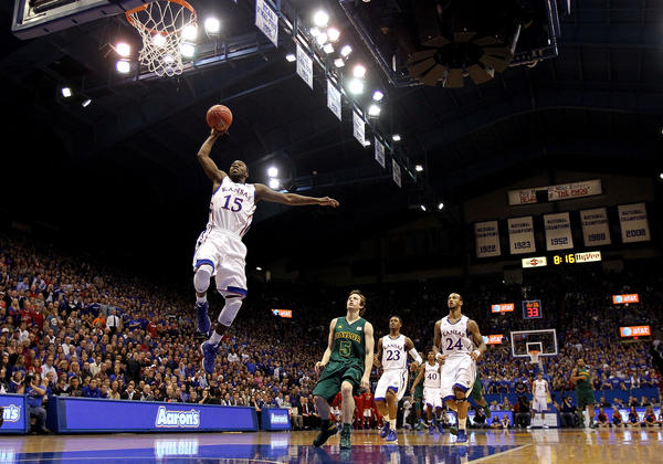 Elijah Johnson #15 of the Kansas Jayhawks scores on a fast break during the game against the Baylor Bears at Allen Fieldhouse on January 14, 2013 in Lawrence, Kansas.