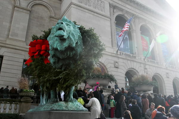 "Spectators gather after the 20th annual ""Wreathing of the Lions"" at the Art Institute Chicago in 2011."