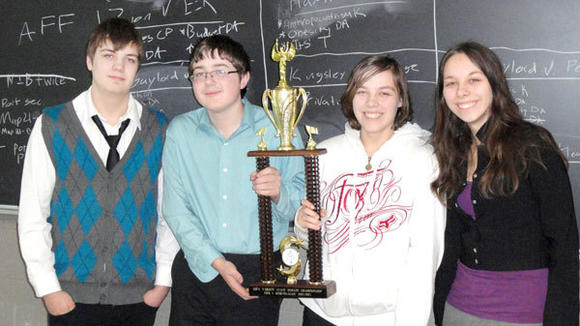 Gaylord High's debate team of Nick Martin, Mitch Kasper, Allison Thornton and Katelynn Thornton (l-r) show off the hardware they won this season.
