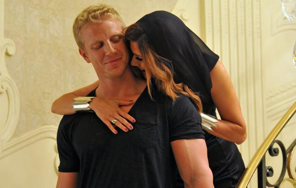 "Sean Lowe and Kacie B. pose during a photo shoot for a romance novel cover on ""The Bachelor."""