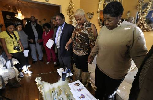"Rose Starnes, right, marks the fifth anniversary of the disappearance of her adopted daughter and niece, Jasmin Acree, with family members and clergy as they pray for Acree in her home. Starnes later stated that, ""As the years go by it gets harder. We miss her and love her and just want her back with us."""