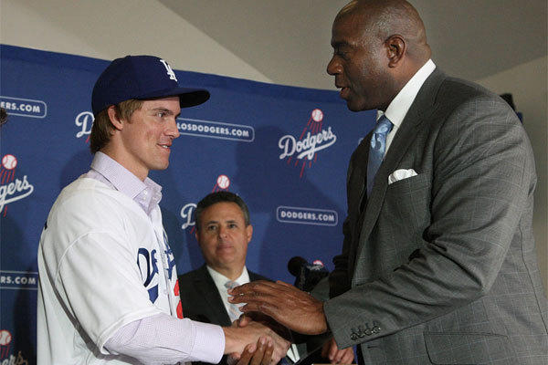 Dodgers co-owner Magic Johnson welcomes new  pitcher Zack Greinke at a news conference at Dodger Stadium last month.