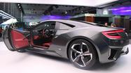 "DETROIT — <span class=""s1"">At the Detroit auto show, </span>Acura <span class=""s1"">broke news on </span>three new models crucial to the brand's growth<span class=""s1"">: </span>the NSX hybrid supercar, a prototype of the next MDX mid-size crossover SUV, and its flagship sedan, the RLX."