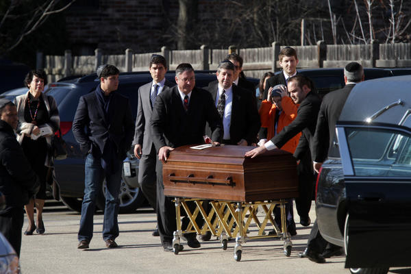 The casket of Reddit co-founder and Internet activist Aaron Swartz is wheeled to the hearse at North Suburban Lubavitch Chabad Central Avenue Synagogue in Highland Park, Ill. Swartz, 26, hung himself Friday, weeks before he was due to stand trial for illegally downloading millions of scholarly papers from MIT.