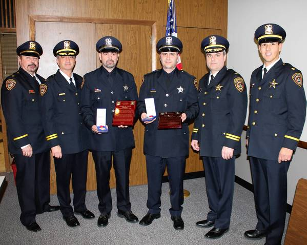 (Left to right) Des Plaines Police Commander Randy Akin, Deputy Chief Nick Treantafeles, Officer Michael Kelly, Officer Michael Oppegard, Deputy Chief Michael Kozak and Commander Louis Wittmer pose for a photograph following the presentation of the Valor Award at the Monday, January 7, 2013, City Council Meeting at City Hall.