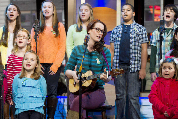 "Singer Ingrid Michaelson, center, has joined students from Sandy Hook Elementary School to record the benefit single ""Somewhere Over the Rainbow."""