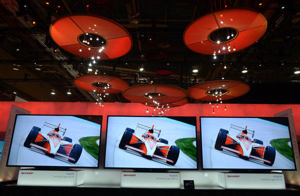 Sharp's Aquos World LED TVs on display at CES this month in Las Vegas. A new study suggests that content and connectivity, not hardware, dominated social-media discussions about the conference.