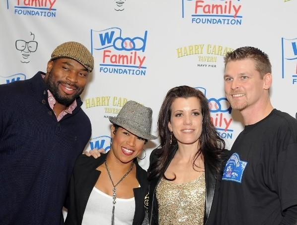 "(L to R) Bear's Israel Idonije, ""Windy City Live"" co-host Val Warner, Sarah Wood and husband and retired Cub Kerry Wood during Woody's Winter Warm-Up January 13th, 2012 at Harry Carays Tavern - Navy Pier."