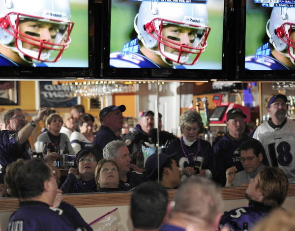 Fans watch the 2012 Ravens-Patriots playoff game.