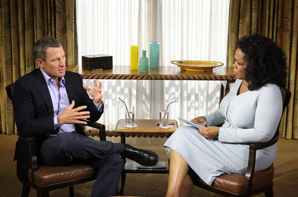 Lance Armstrong talks with Oprah Winfrey in Austin, Texas, on Monday.