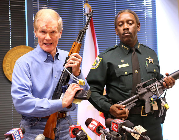 U.S. Sen. Bill Nelson (left) holds an AK-47 assault rifle, with Orange Sheriff Jerry Demings holding a Bushmaster .223, during a news conference on the debate over gun control policy, in Orlando, Fla., Tuesday, Jan. 15, 2013.
