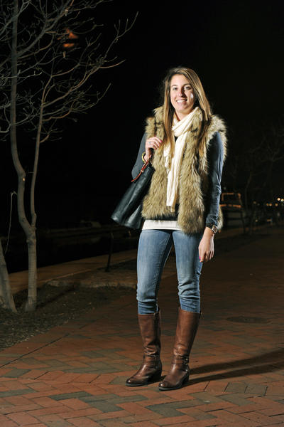 "When it comes to ""trendy"" style, Ali Martin, 25, showed how to make it look comfy and casual as she joined a friend for dinner at RA Sushi. The Aerotek marketing and recruiting coordinator sported a cream scarf from Old Navy tucked into a faux-fur Michael Kors vest from Nordstrom over a charcoal long sleeve J. Crew long-sleeved T-shirt and Forever 21 skinny jeans. The Federal Hill resident added brown Aldo riding boots, a Michael Kors watch from Nordstrom and a navy tote from the Tory Burch outlet. Her enameled gold bangle was a gift; its color is one of her current fashion passions. ""I'm really into the color mint,"" she said. ""I also like skinny jeans with boots, pleather pants and plaid."""