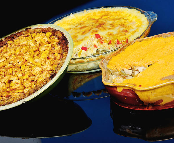 Pies typically have a pastry crust, but not these. The apple pie, left, has a walnut crust. The bacon-onion-pepper quiche, center, has a rice crust. And a sweet potato top crust covers the chicken-and-root-veggie pot pie at right.
