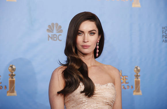 Presenter Megan Fox poses backstage at the 70th annual Golden Globe Awards