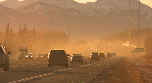 Traffic stirring up dust on the New Seward Hywy.