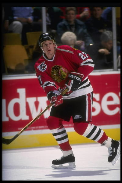 Jeremy Roenick looks for the pass.