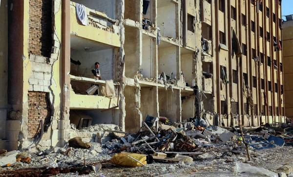 The explosions at Aleppo University in Syria sheared the facades off buildings, blew out windows, set cars ablaze and left bodies scattered across the campus. At least 82 people were killed.