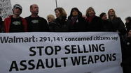 Gun-control advocates, including parents of victims of mass shootings, delivered nearly 300,000 signatures to a Wal-Mart store a short drive from Sandy Hook Elementary School Tuesday morning, calling on the nation's largest firearms seller to pull military-style rifles off its shelves.