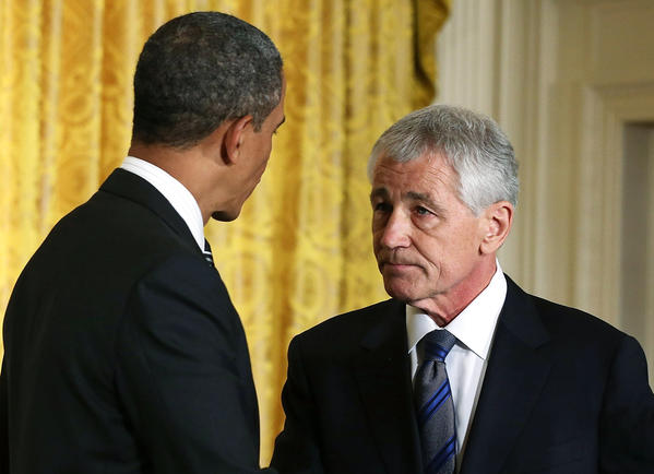 Former Sen. Chuck Hagel, President Barack Obama's nominee for defense secretary, shares the podium with the president as his nomination is announced on Jan. 7.