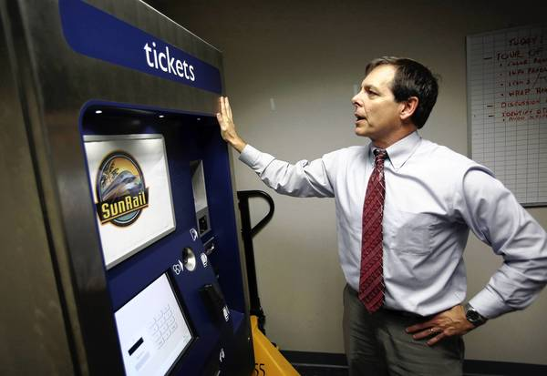 Steve Olson of the Florida Department of Transportation checks out prototype SunRail ticket kiosk.
