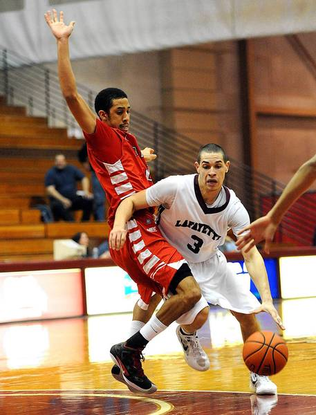 Lafayette's Tony Johnson (right) drives to the basket in front of Saint Francis' Kam Ritter (left) in the second half of their basketball game Tuesday December 4, 2012.
