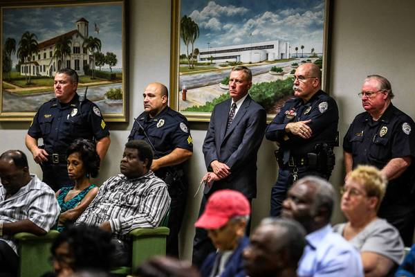 Sanford Mayor Jeff Triplett, and Sanford police officers listen as five candidates for Chief of Police participate in a question and answer session with local residents at City Hall in Sanford on January 15, 2013.
