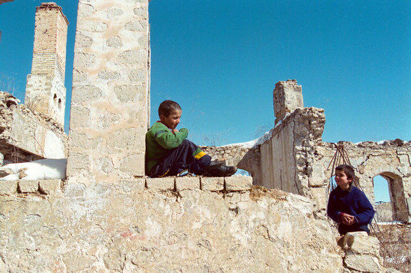 Armenian children play in the ruins of ancient Shusha, a village destroyed during the 1991-94 war between Armenians and Azerbaijanis for Nagorno-Karabakh. The remote mountain enclave remains in dispute nearly two decades after a cease-fire froze fighting.