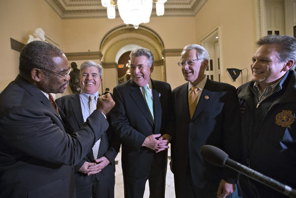From left, Rep. Gregory W. Meeks, D-N.Y., Suffolk County, N.Y., Executive Steve Bellone, Rep. Peter King, R-N.Y., Rep. Steve Israel, D-NY, and Nassau County Executive Edward P. Mangano, celebrate just after the House of Representatives passed a $50.5 billion emergency aid bill for states hit by Superstorm Sandy, Tuesday, at the Capitol in Washington. The measure is expected to pass the Senate as well.