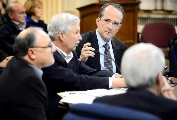 Local attorney D. Bruce Poole facing at right, introduces Dane Bauer, center with Daft, McCune and Walker Inc., and Tim Elliott of the real estate development company Sora Development, speak to Hagerstown City Council members Tuesday night at City Hall.