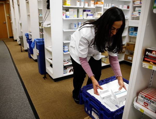 Lizzette Perez, head pharmacist at a Jewel-Osco in Chicago, unloads flu vaccine on Tuesday.