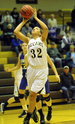 Bethlehem Catholic's Kalista Walters (32) drives to the basket for a lay-up against Nazareth High School Tuesday night.