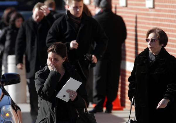 Mourners leave the Tuesday funeral for Reddit co-founder and Internet activist Aaron Swartz at North Suburban Lubavitch Chabad Central Avenue Synagogue in Highland Park.