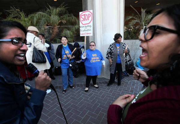 Shruti Purkayastha, left, and Carla Gonzalez lead a rally protesting L.A. Unified's plans to overhaul Crenshaw High.