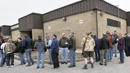 Lines wrapped around the exhibition hall of the Maryland State Fairgrounds by noon Friday. Hundreds chatted outside, waiting for the doors to open to Baltimore County's first gun show of year. The parking lots filled up as the afternoon wore on.
