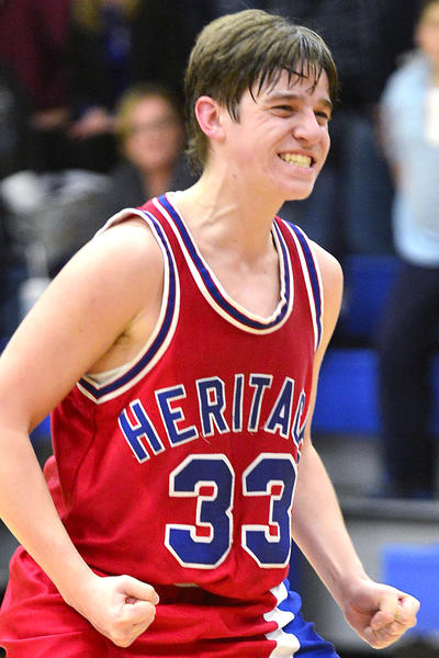 Heritage Academy's Chris Harrell celebrates after making the winning free throw to beat Broadfording on Tuesday night in the Mason Dixon Christian Conference.