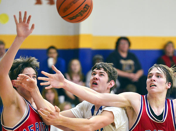 Broadfording Christian's Ben Cradduck, center, battles for a rebound between Heritage Academy's Chris Harrell, left, and Alex Cosner, right, on Tuesday during the Eagles' 62-61 victory.