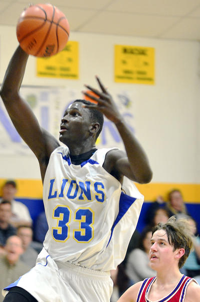 Broadfording Christian's Mawdo Sallah drives to the basket for a layup on Tuesday during the Lions 62-61 loss to Heritage Academy.