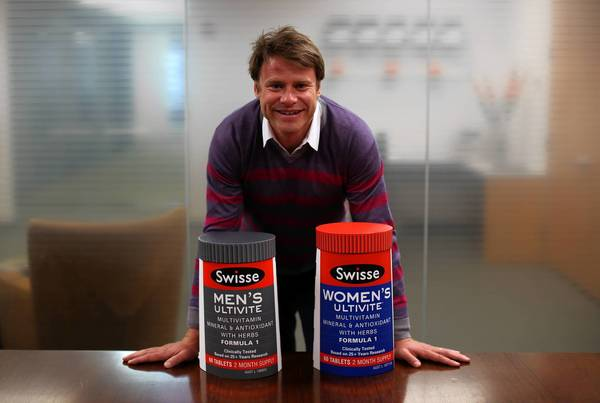 Swisse CEO Radek Sali displays two of the company's products.