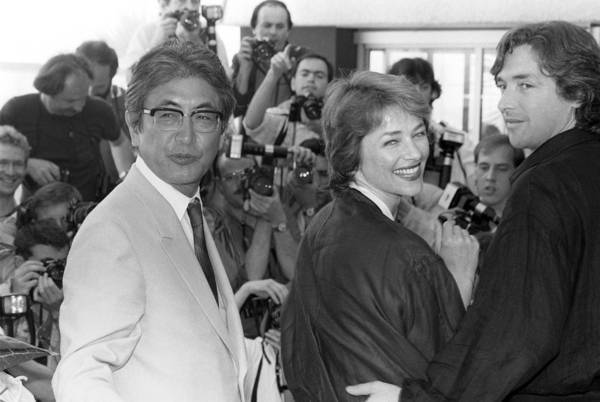 "Nagisa Oshima, left, accompanies actors Charlotte Rampling and Anthony Higgins to the presentation of his film ""Max Mon Amour"" at the Cannes International Film Festival in 1986."