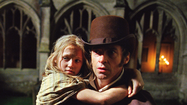Still of Hugh Jackman and Isabelle Allen in Les Misérables