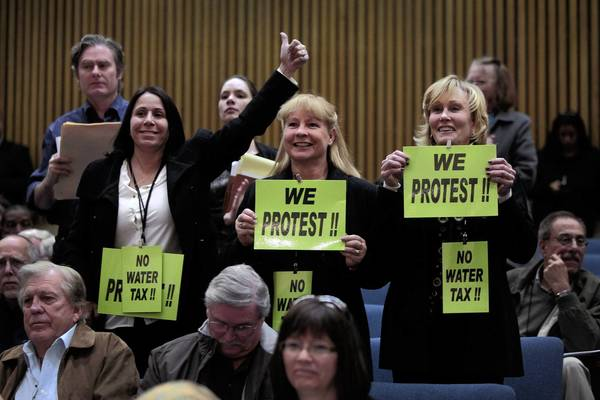 Opponents of the proposal to impose new fees on property owners to help pay for upgrades to the county's storm drain network make their feelings known at a Los Angeles County Board of Supervisors public hearing. The board extended the protest period on the issue by 60 days.