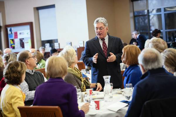 Tribune columnist John Kass speaks before about 250 people at a bacon-and-egg breakfast Tuesday at Elmhurst College.