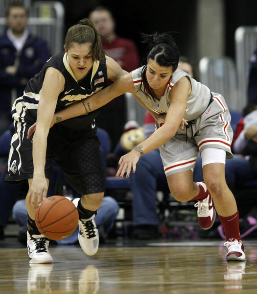 South Dakota native Sam Ostarello, left, of Purdue has been honored by the Big Ten Conference.