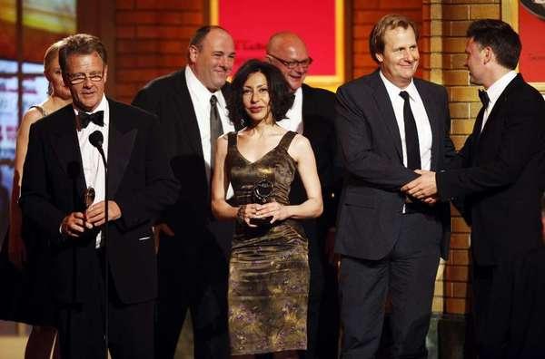 "Yasmina Reza, center, receiving the 2009 Tony Award for best play for ""God of Carnage."""