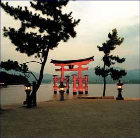 View the iconic, offshore Otorii Gate from Miyajima Island.