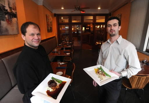 Nathan Roth, executive chef (left) and Arti Kamberaj, general manager of River Grille in Easton at their Northampton Street restaurant.
