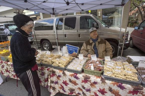 Jim Russell sells Cate macadamias and dried persimmons grown in Fallbrook.